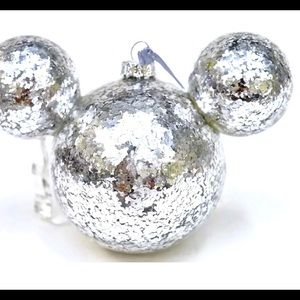 Disney silver confetti Mickey icon ornament.